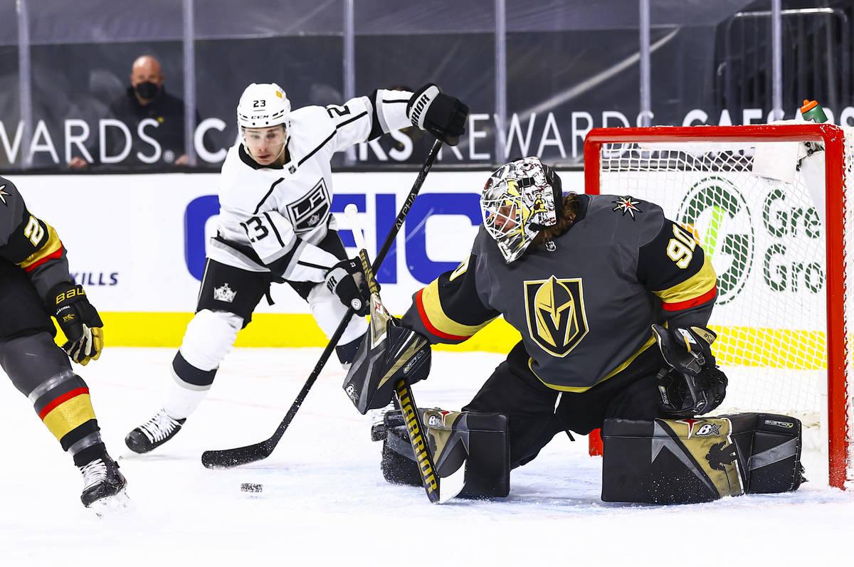 Golden Knights goaltender Robin Lehner (90) looks to block a shot from Los Angeles Kings Dustin ...