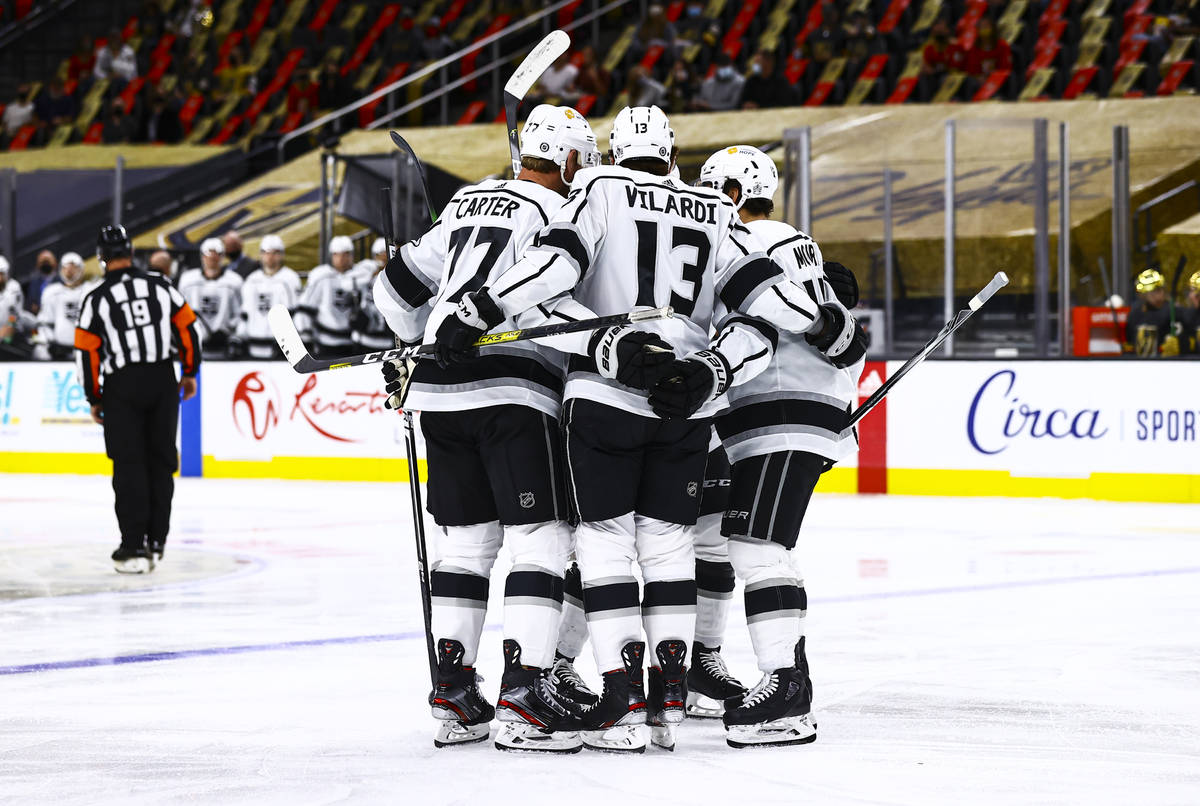 The Los Angeles Kings celebrate a goal against the Golden Knights during the first period of an ...