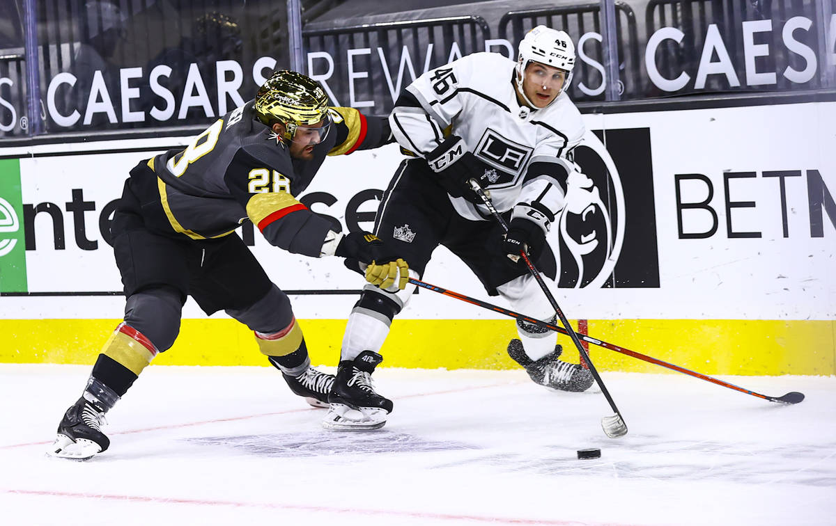 Los Angeles Kings' Blake Lizotte (46) looks to pass the puck under pressure from Golden Knights ...