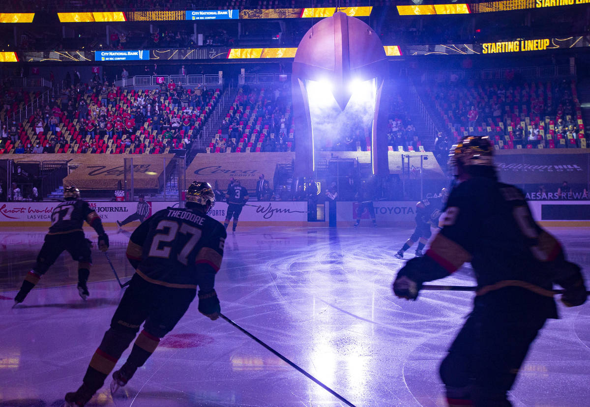 The Golden Knights warm up before playing the Los Angeles Kings in an NHL hockey game at T-Mobi ...