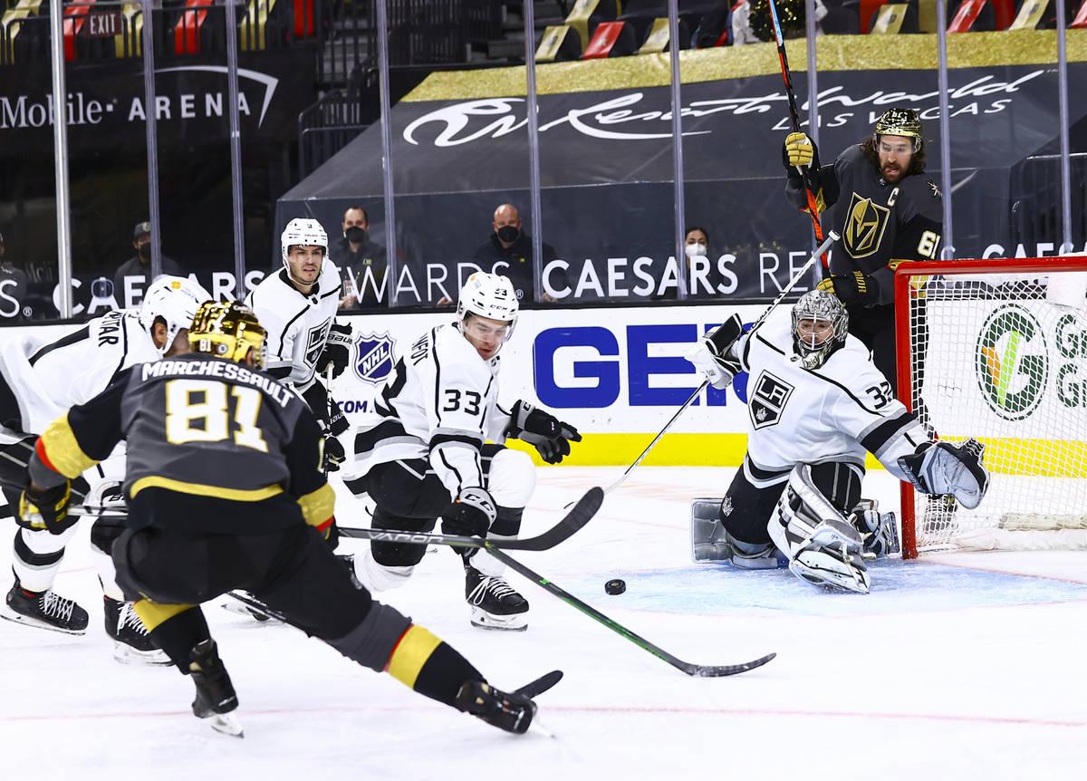 Los Angeles Kings goaltender Jonathan Quick (32) looks to block a shot from Golden Knights' Jon ...