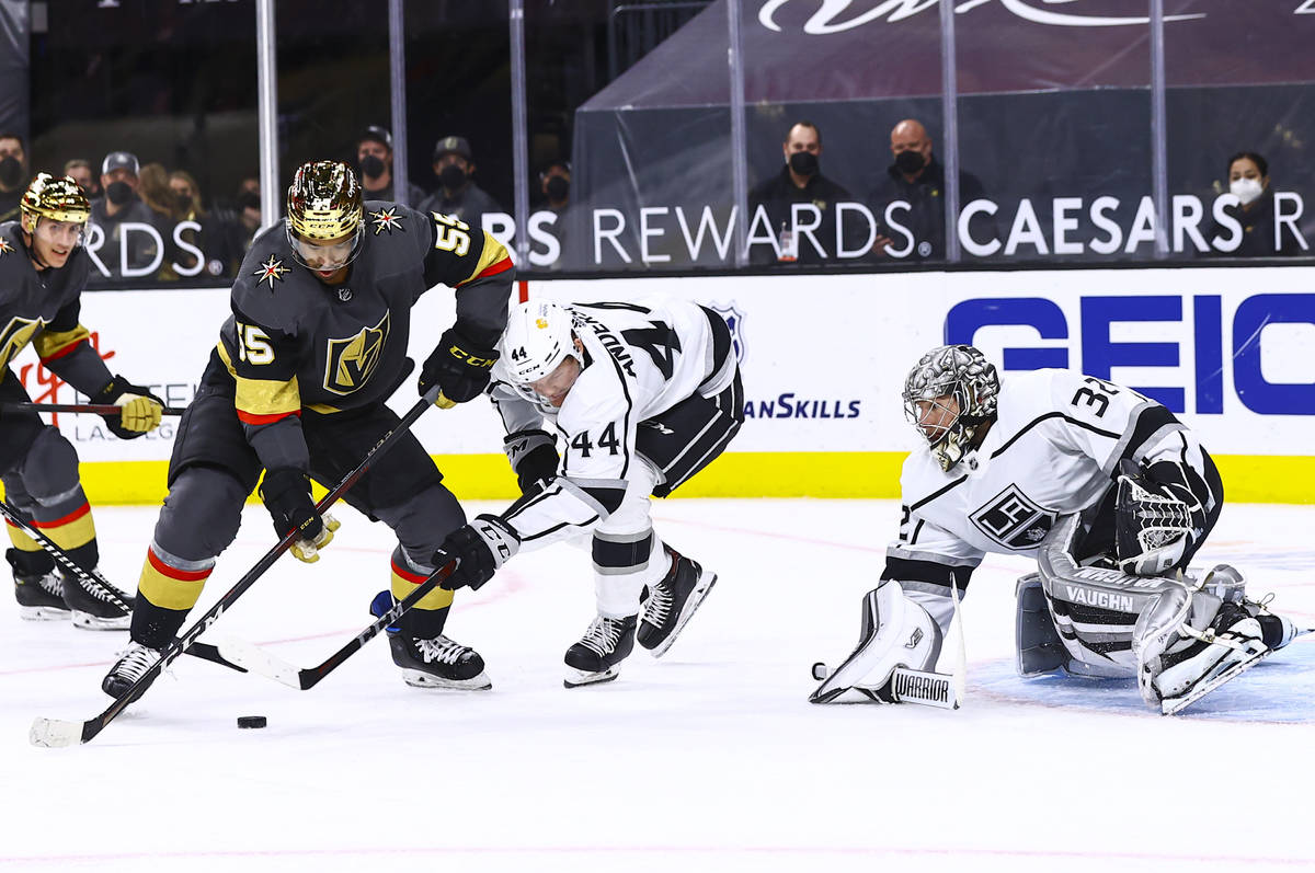 Golden Knights' Keegan Kolesar (55) moves the puck in front of Los Angeles Kings' Mikey Anderso ...