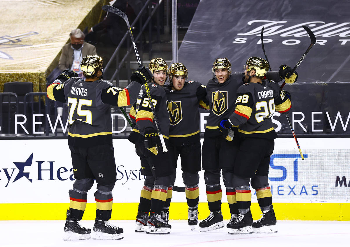 Golden Knights' Tomas Nosek, second from right, celebrates his goal with teammates during the s ...