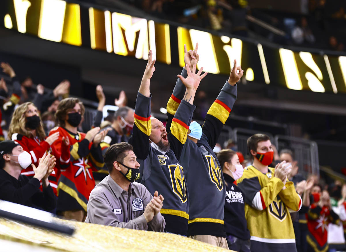 Golden Knights fans celebrate a goal by Tomas Nosek, not pictured, during the second period of ...