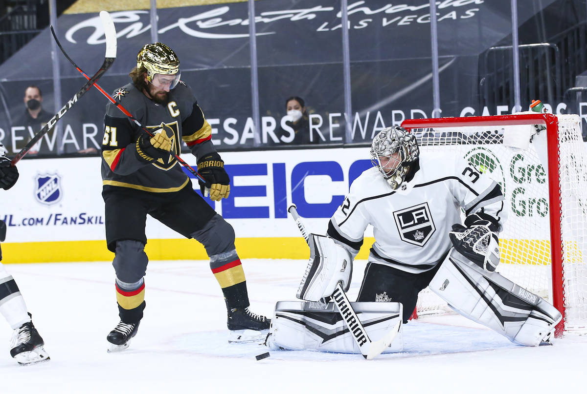 Los Angeles Kings goaltender Jonathan Quick (32) blocks the puck in front of Golden Knights' Ma ...