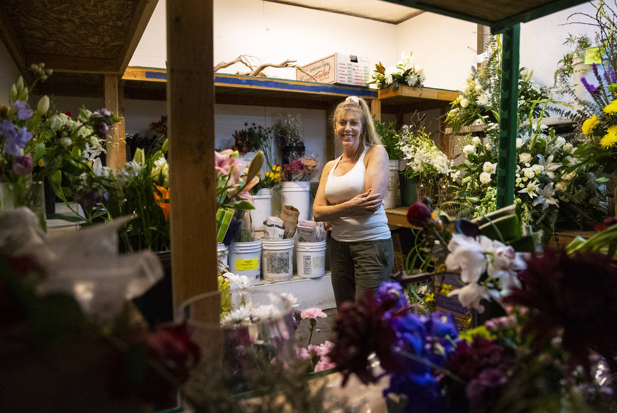 Debbie Newson-Babina, owner of Las Vegas Floral Wholesale, poses for a portrait at her business ...