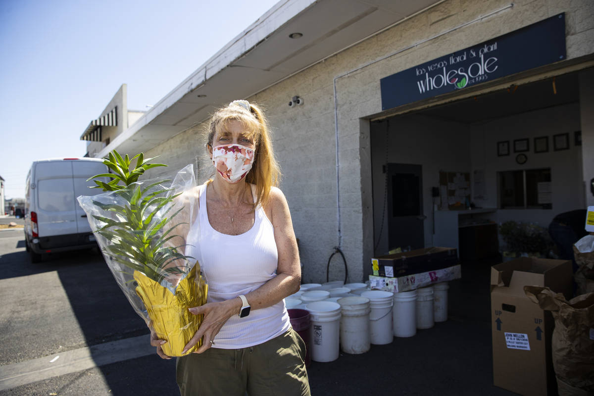 Debbie Newson-Babina, owner of Las Vegas Floral Wholesale, poses for a portrait with sold-out l ...