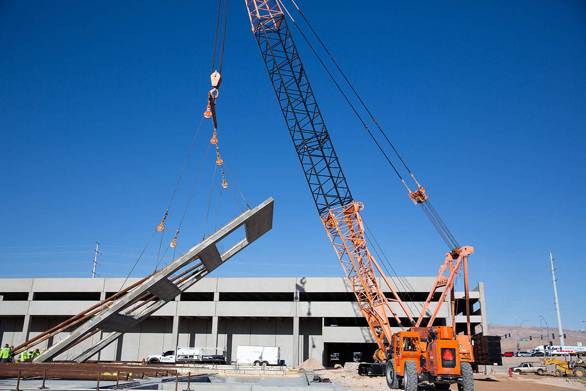 Crews begin lifting walls Monday, March 29, 2021, for the mixed-use development project UnCommo ...