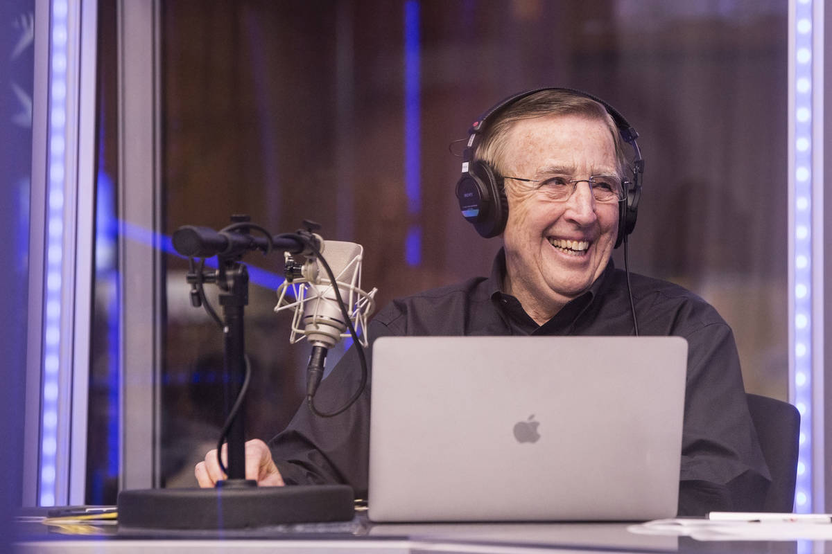Brent Musburger shares a laugh with staff members during a live broadcast on Sunday, March 12, ...