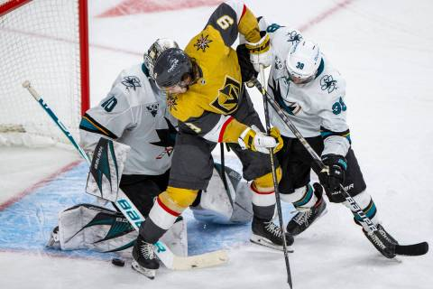 Golden Knights center Cody Glass (9) looks to get the puck into the net past San Jose Sharks go ...