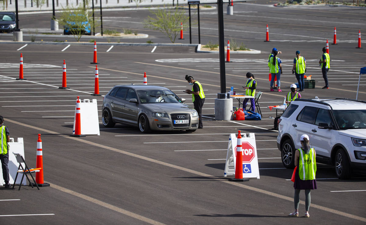 People check in to get tested at the drive-thru COVID-19 testing site at Allegiant Stadium in L ...