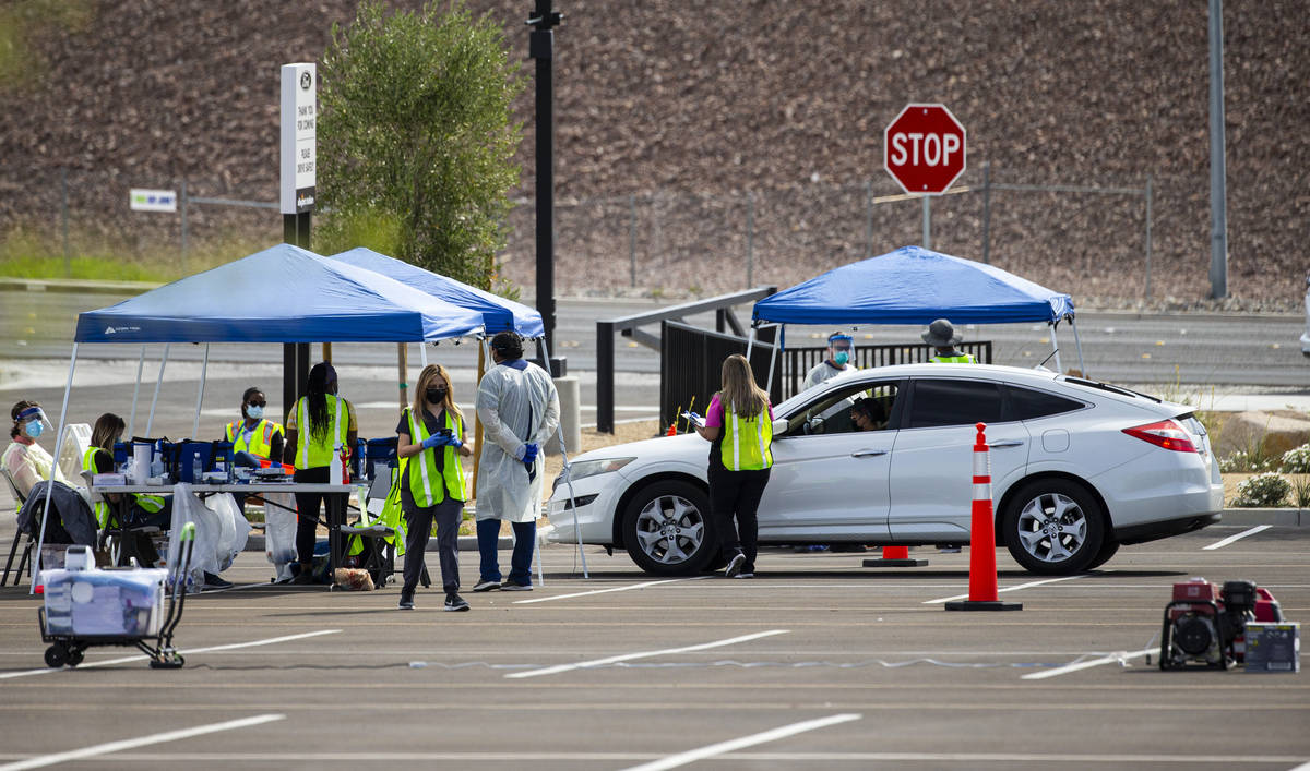 Tests for COVID-19 are conducted at the testing site at Allegiant Stadium in Las Vegas on Wedne ...