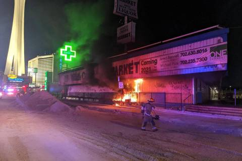 Firefighters respond to a fire at the former White Cross Drugs building at 1700 Las Vegas Blvd. ...