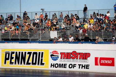 Fans watch as the Dodge NHRA Finals are underway at Las Vegas Motor Speedway on Sunday, Nov. 1, ...