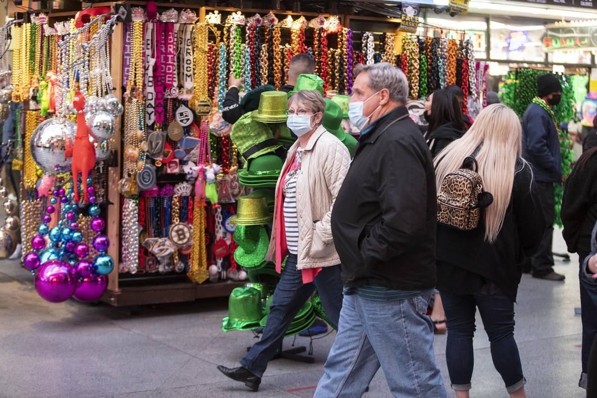 People visit the Fremont Street Experience in Las Vegas, on Friday, March 12, 2021. (Erik Verdu ...