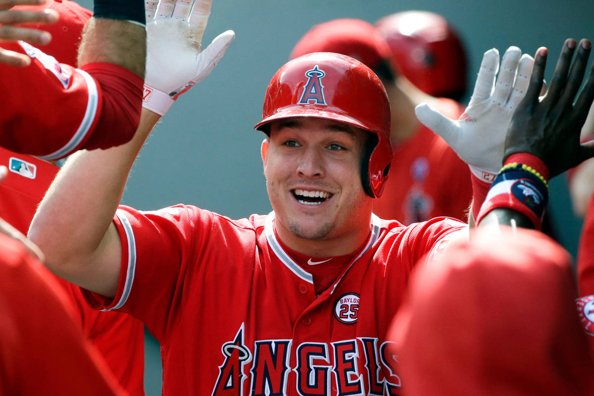 In this Sept. 10, 2017, file photo, Los Angeles Angels' Mike Trout is greeted in the dugout aft ...
