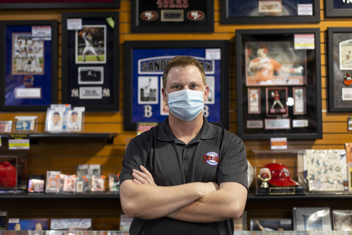 Jeremy Brown at his Neonopolis shop, Ultimate Sports Cards and Memorabilia, on Thursday, March ...