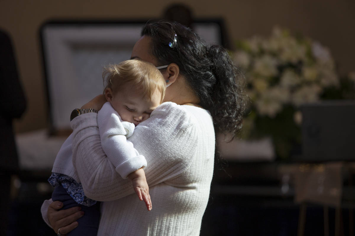Skyler Morales's 1-year-old daughter, Layla Rain Morales, is held by her great aunt Cherry Mora ...