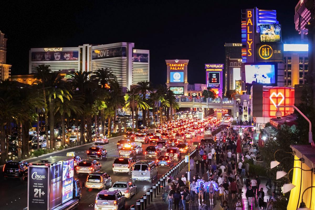 The Strip is packed outside Paris Las Vegas on Friday, March 19, 2021, in Las Vegas. (Benjamin ...