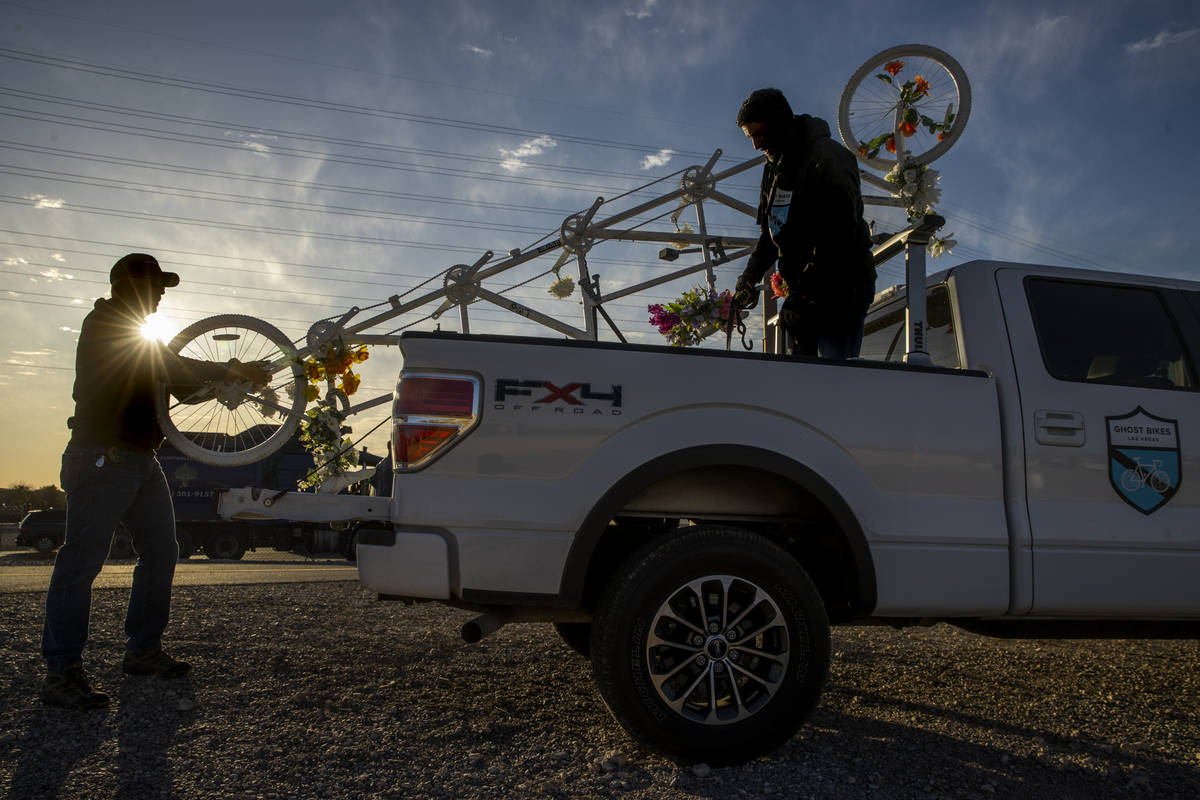 Steve White, left, and Pat Treichel with Ghost Bikes Las Vegas relocate their 5-person bike fro ...