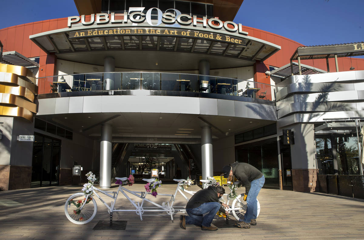Pat Treichel, left, and Steve White with Ghost Bikes Las Vegas relocate their 5-person bike to ...