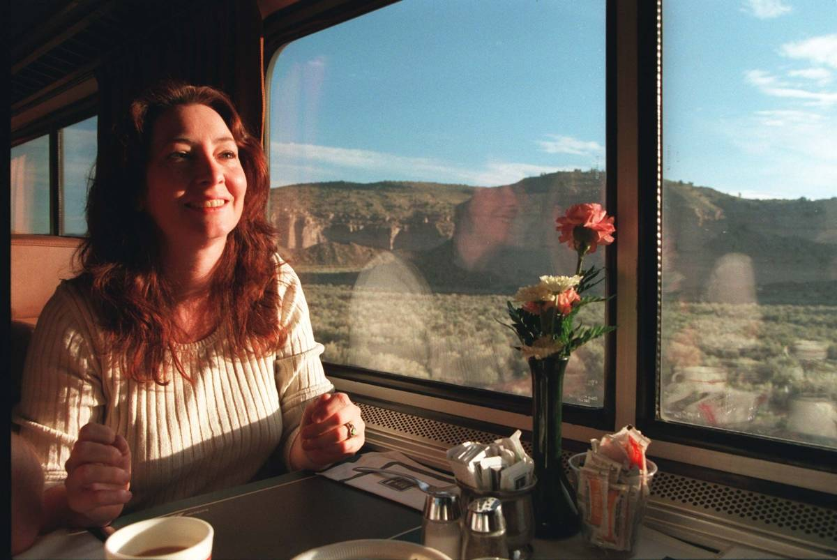 Scianna Augustine, a travel agent from Las Vega,s has her morning coffee as the Amtrak's Desert ...