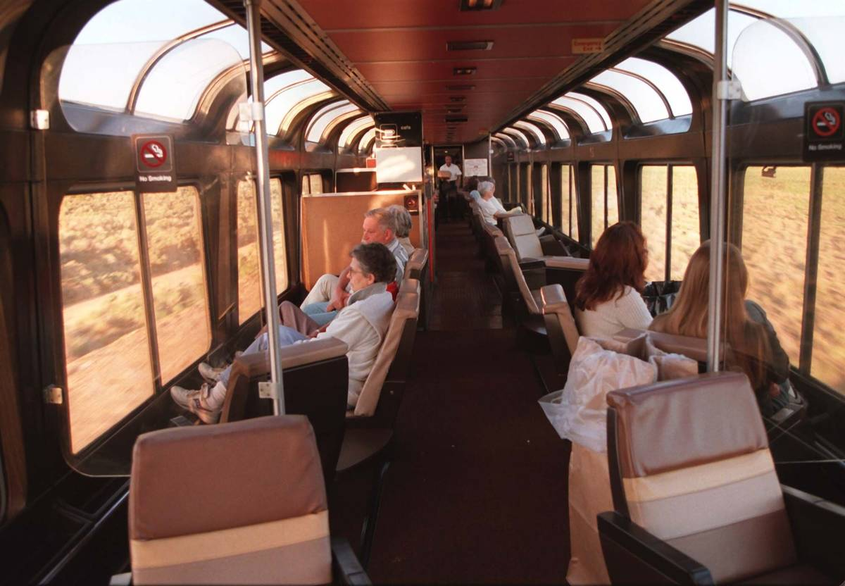 As the Amtrak's Desert Wind heads towards Las Vegas, passengers enjoy the scenery and conversat ...