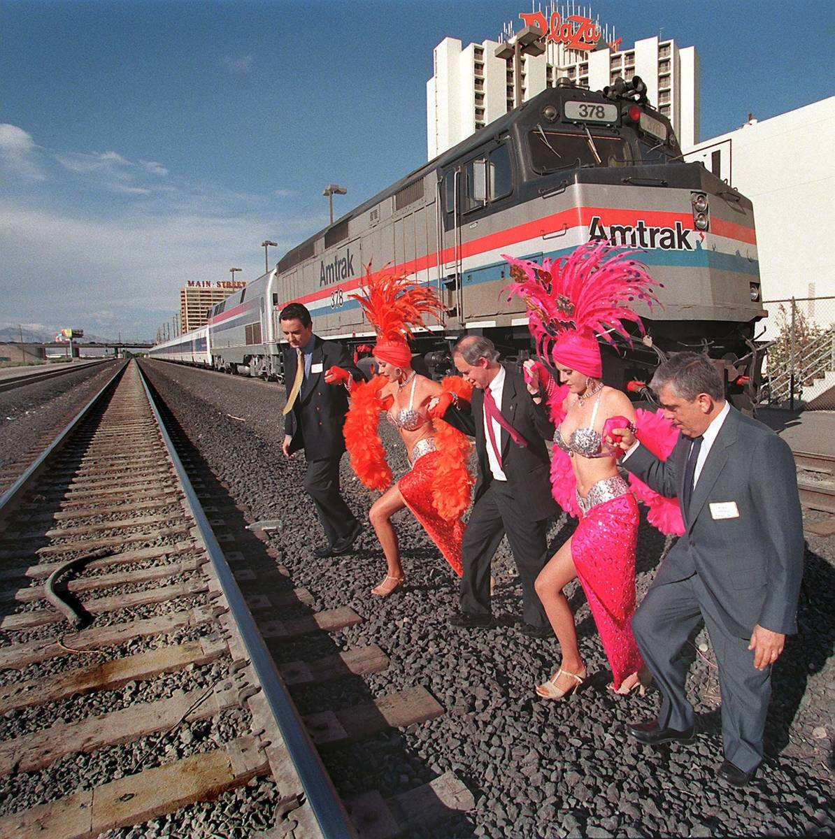 Railroad executives Gustavo Gonzalez, from left, Gil Mallery and Lucas Oriol assist Las Vegas s ...