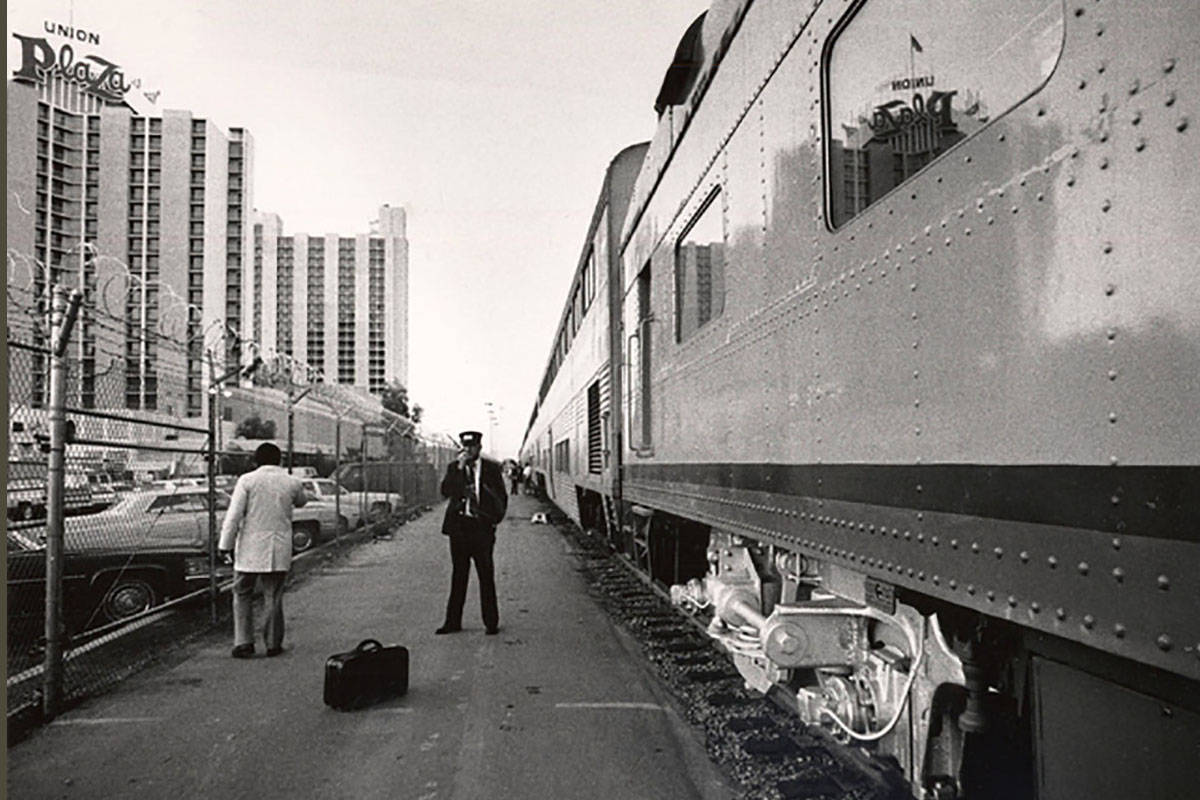 An Amtrak train is seen next to The Plaza hotel-casino in downtown Las Vegas on Oct. 24, 1986. ...