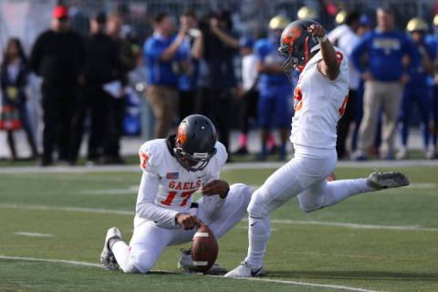 Bishop Gorman kicker Derek Ng competes in the NIAA 4A state championship football game in Reno, ...