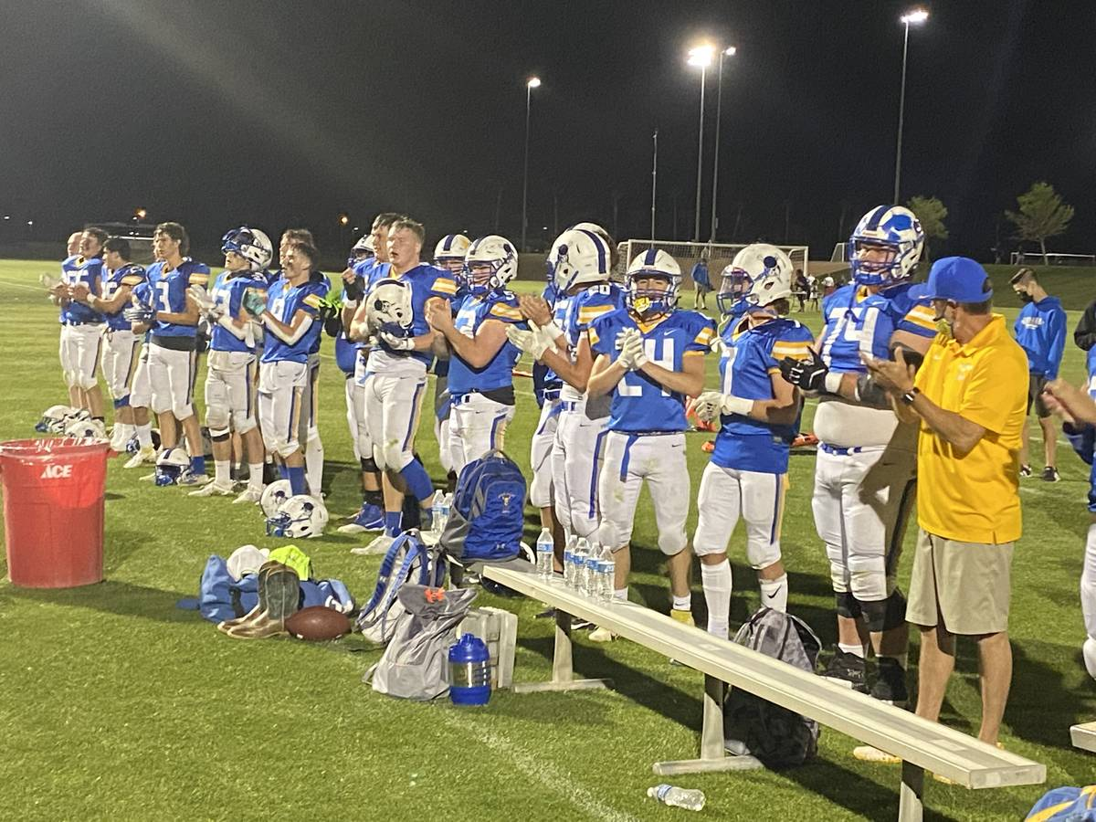 Moapa Valley players sing the school's fight song in celebration of an 18-14 win over rival Vir ...