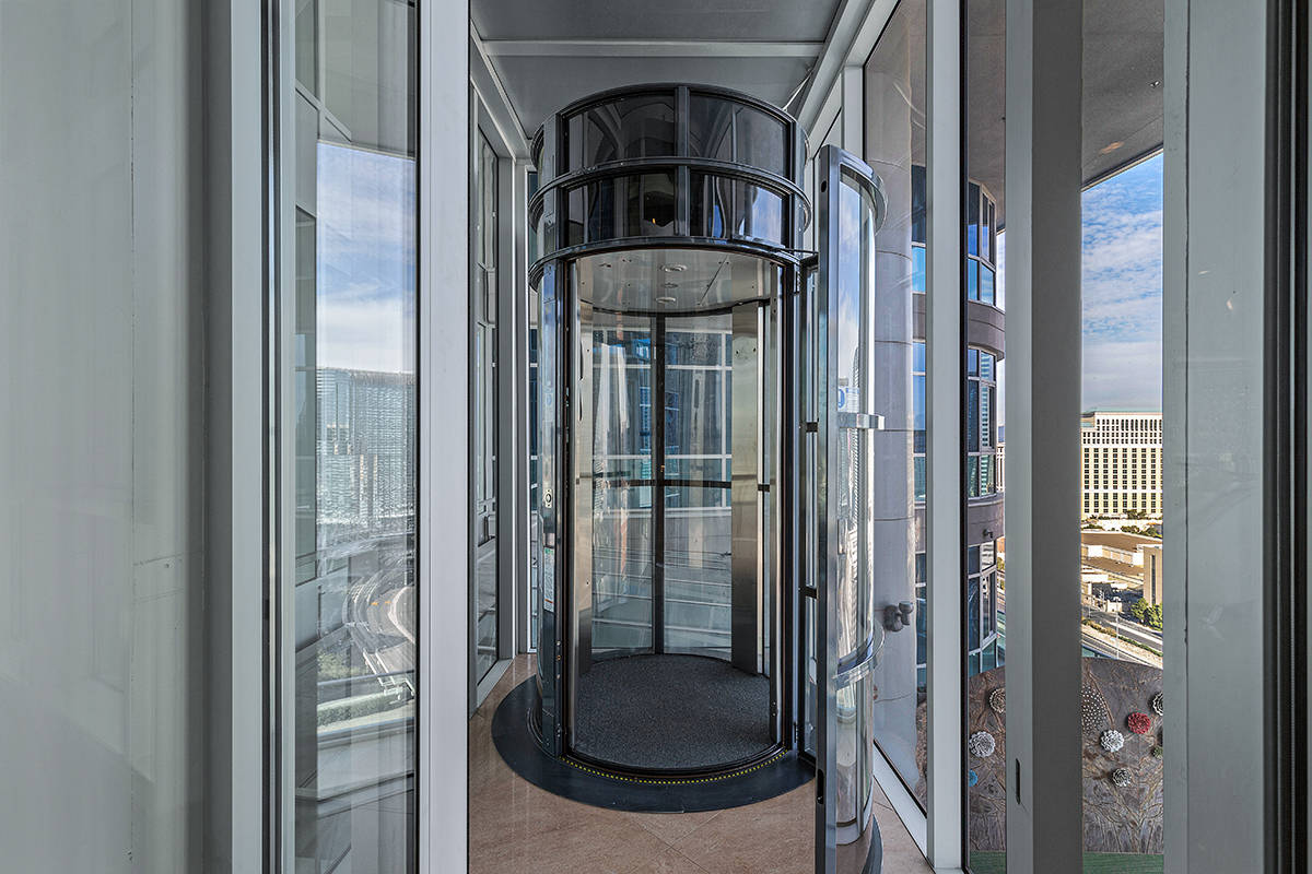 The home features a pneumatic vacuum elevator that connects its three levels. (Red Luxury Real ...