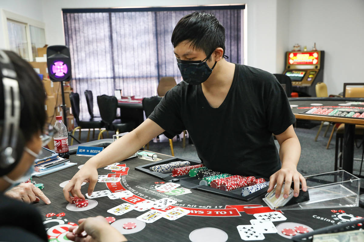 Marvin Ly practices dealing blackjack at the CEG Dealer School in Las Vegas, Thursday, April 1, ...