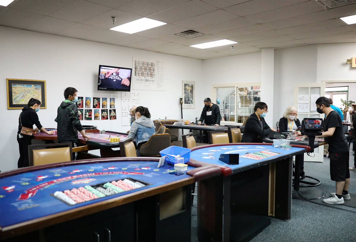 Students at work at the CEG Dealer School in Las Vegas, Thursday, April 1, 2021. As COVID-19 re ...