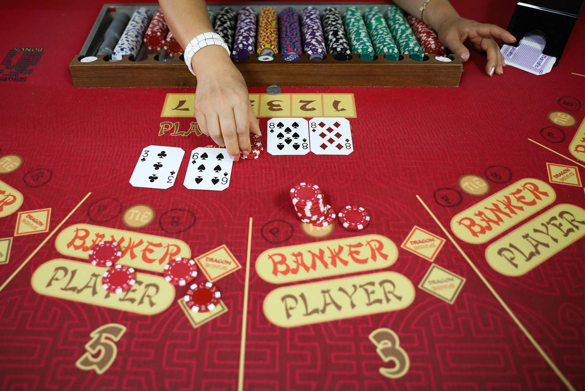 Soon Lee practice dealing for baccarat at the CEG Dealer School in Las Vegas, Thursday, April 1 ...