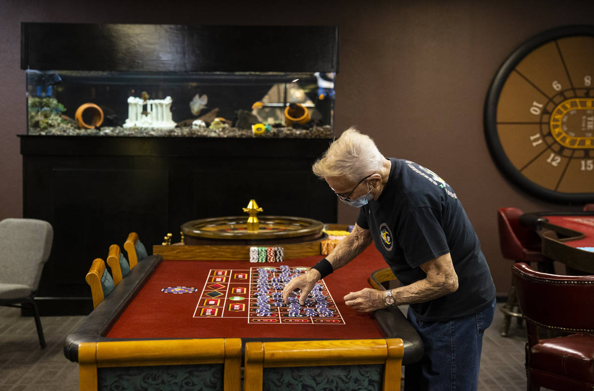 Robert Poletta, 88, arranges chips at a roulette table during class at the Crescent School of G ...
