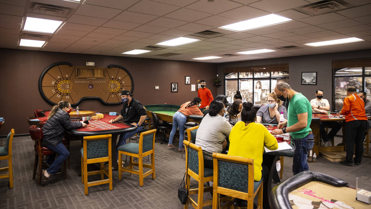 Students work with different table games during class at the Crescent School of Gaming and Bart ...