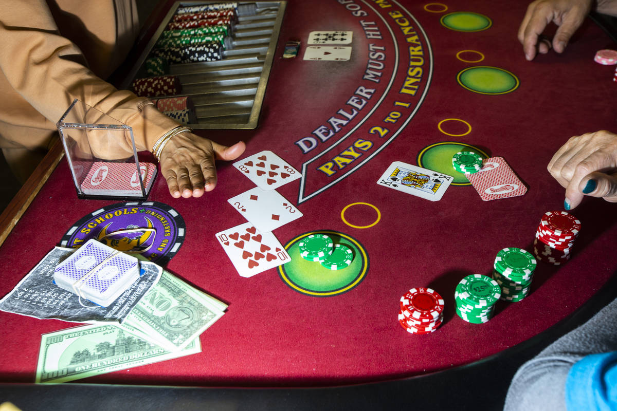 Instructor Yodit Girma works a blackjack table during class at the Crescent School of Gaming an ...