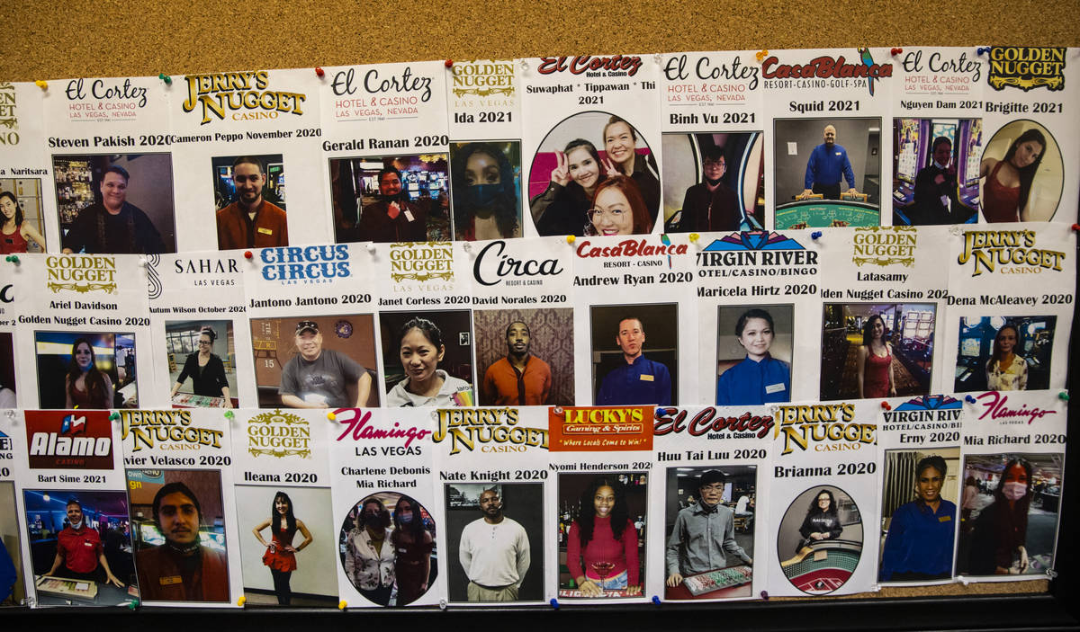 A wall displays pictures of students who have graduated at the Crescent School of Gaming and Ba ...