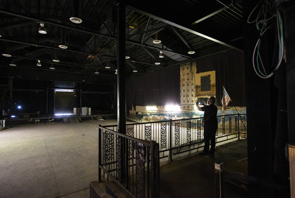 A reporter takes a picture in the Huntridge Theater the day after Dapper Companies founder and ...