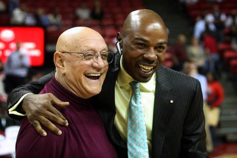 Former Las Vegas basketball coach Jerry Tarkanian, left, greets former player Greg Anthony, rig ...