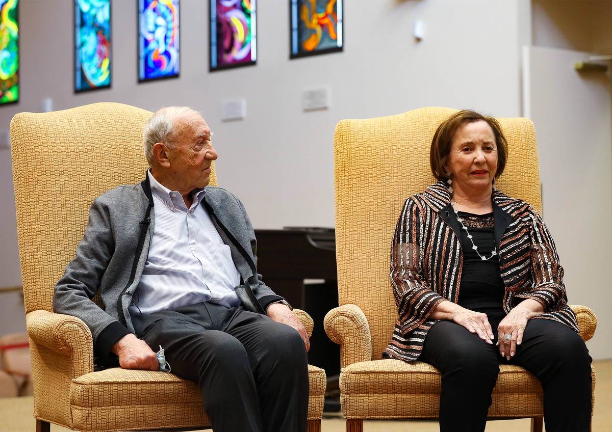 Holocaust survivors Henry Kronberg, left, and Judy Mack, right, speak about their experiences a ...