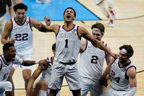 Gonzaga guard Jalen Suggs (1) celebrates making the game winning basket against UCLA during ove ...