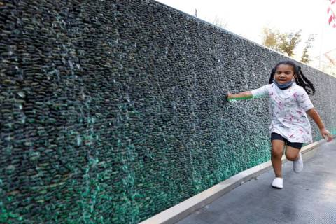 Maia Olivas, 6, of Houston, Texas runs along the water walls at The Park on the Las Vegas Strip ...