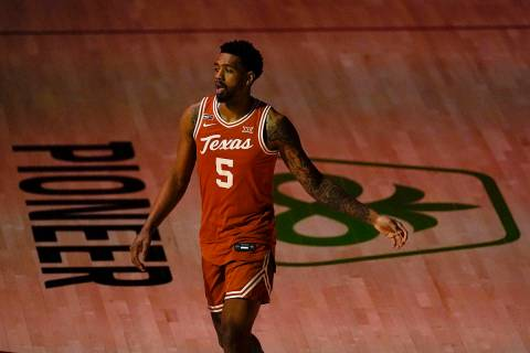 Texas forward Royce Hamm Jr. warms up before an NCAA college basketball game against Iowa State ...