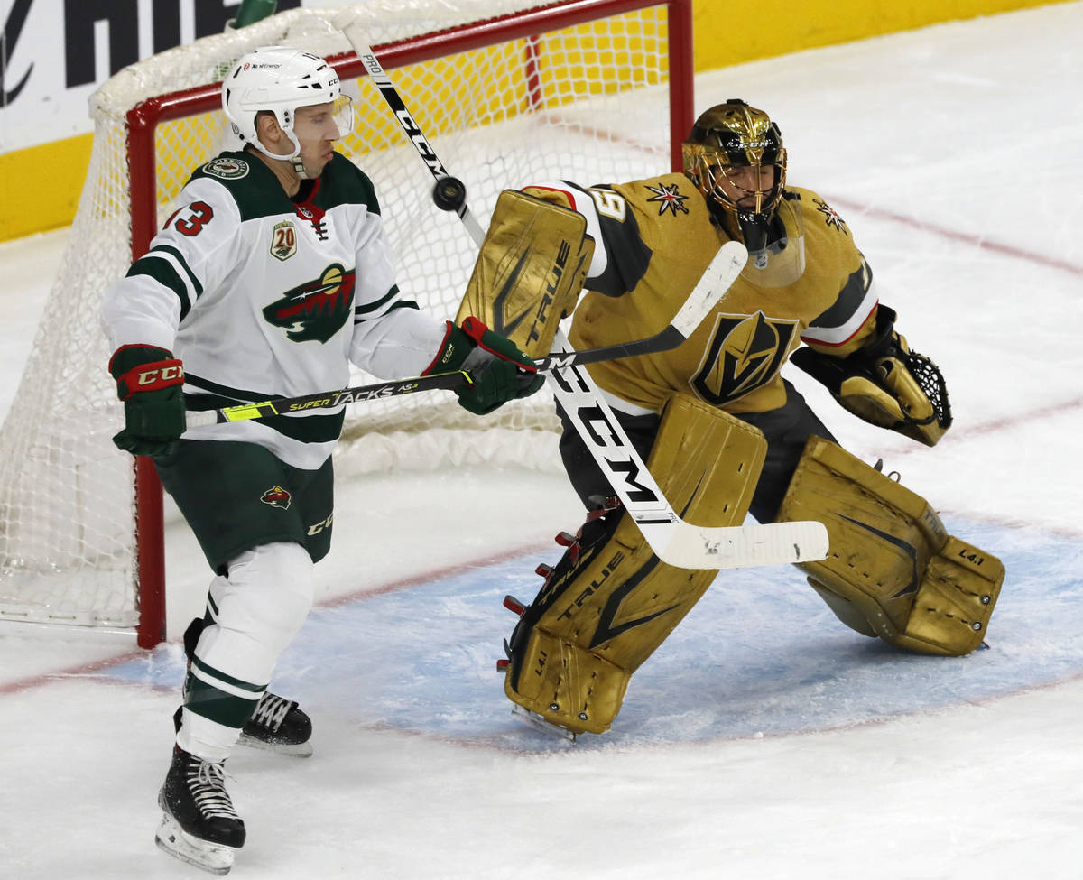 Vegas Golden Knights goaltender Marc-Andre Fleury (29) makes a save asMinnesota Wild center Nic ...