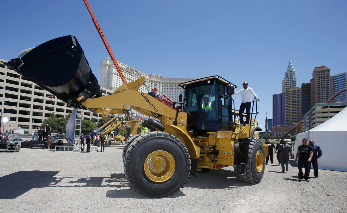 WBC welterweight champion Floyd Mayweather Jr. arrives on a bull dozer during a groundbreaking ...