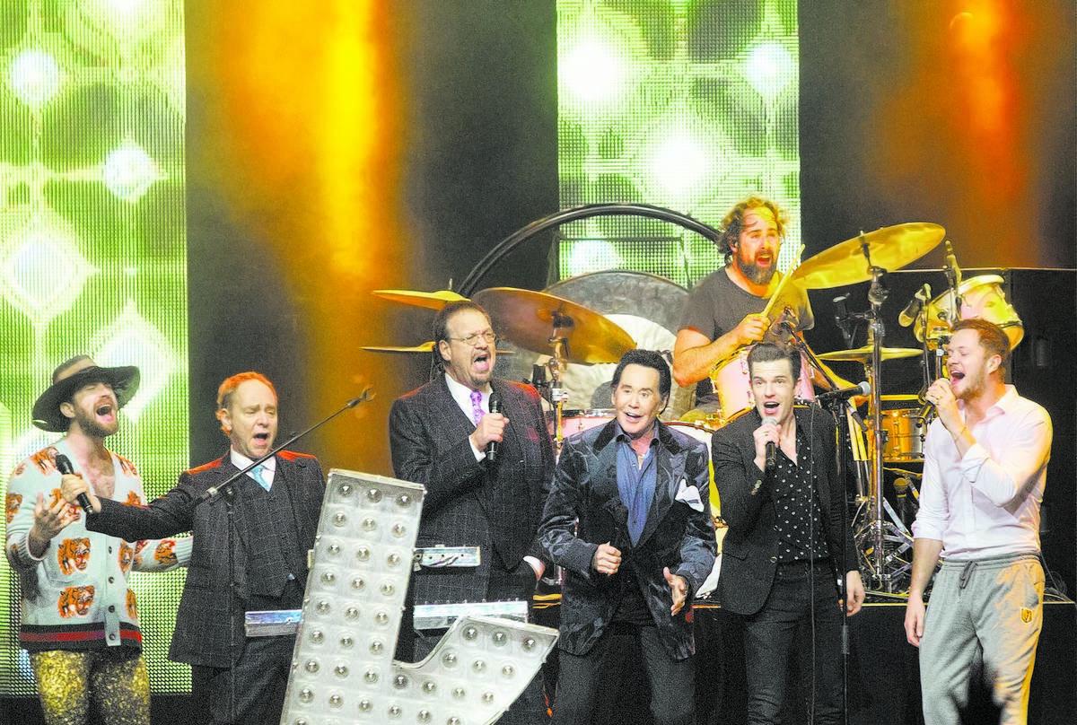 Daniel Platzman, Teller, Penn Jillette, Wayne Newton, Brandon Flowers and Dan Reynolds sing &qu ...