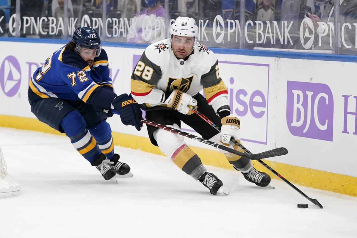 Vegas Golden Knights' William Carrier (28) controls the puck as St. Louis Blues' Justin Faulk ( ...