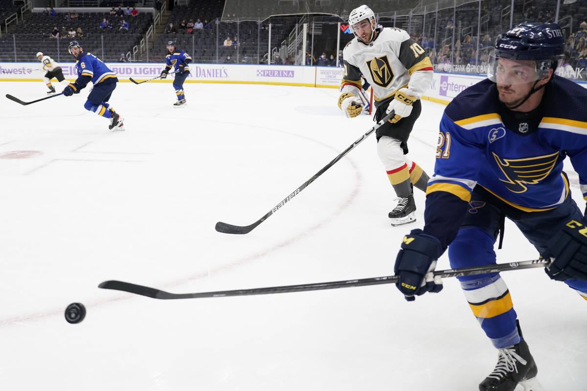 St. Louis Blues' Tyler Bozak, right, passes as Vegas Golden Knights' Nicolas Roy (10) skates by ...
